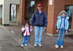Robert Strizic of Windward walks daughters Madison and Alexandra to school.