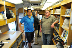 Library staff Jorge Guevara and John Williams in the bookmobile.