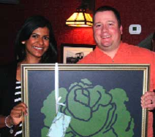 Christina-and-John-Ganev-receive-a-Cabbagetown-Chalkboard-at-the-AGM