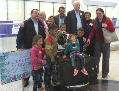 The Bakour family, sponsored by Metropolitan United Church, arrived on Dec.6. (Photo by Mary Stockdale Vernon.)